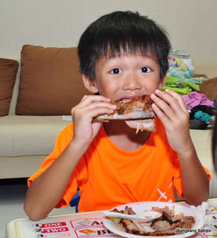 child enjoying baby back rib